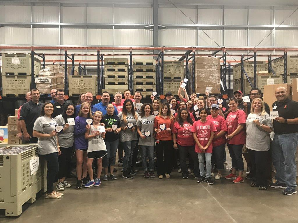 Picture of 40 United volunteers came together in the inaugural outreach event to build food boxes From Our Family to Yours.